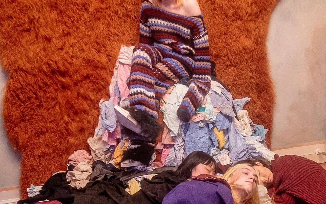 People lying on a pile of excessive inventory
