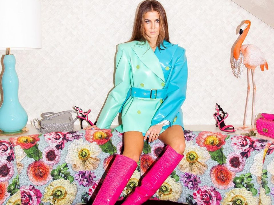 Nina Sandbech wearing a blue jacket and pink boots made of vegan leather