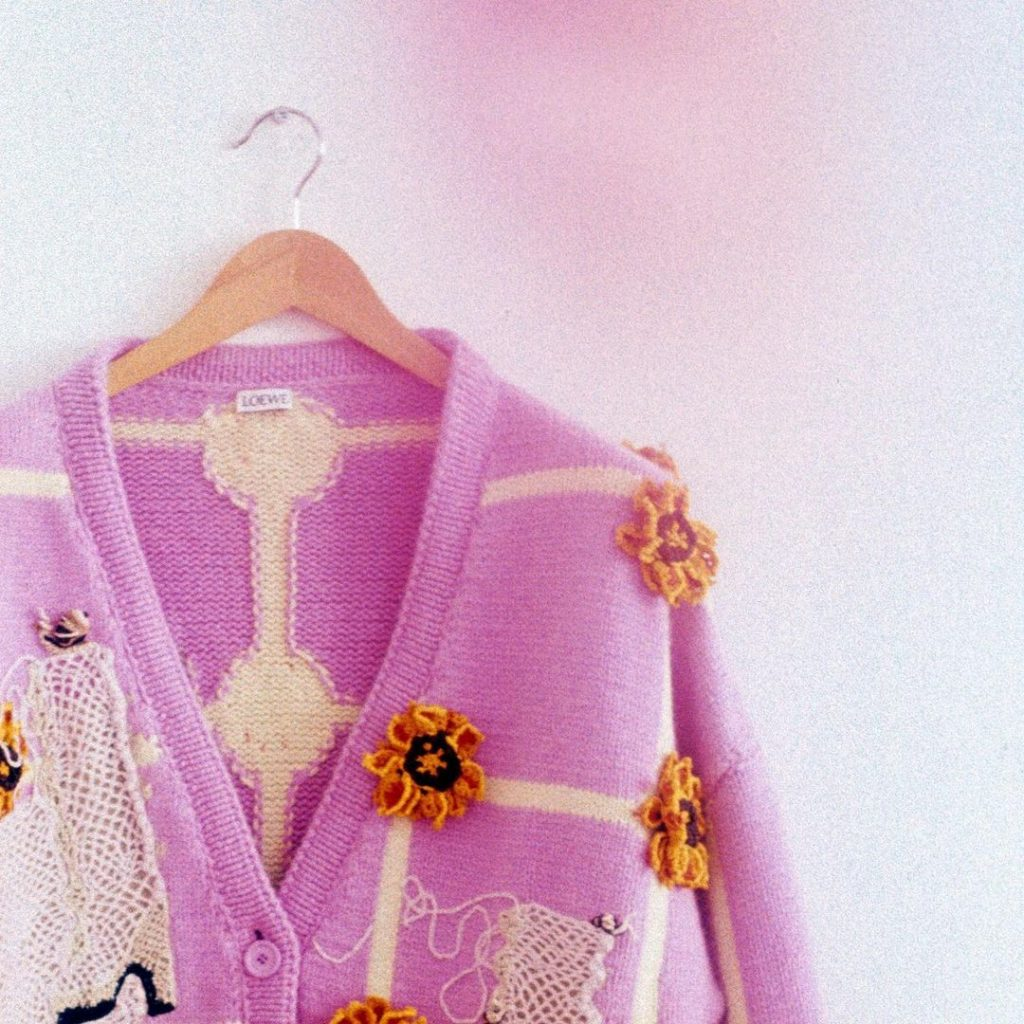 Pink Loewe cardigan with visible mending